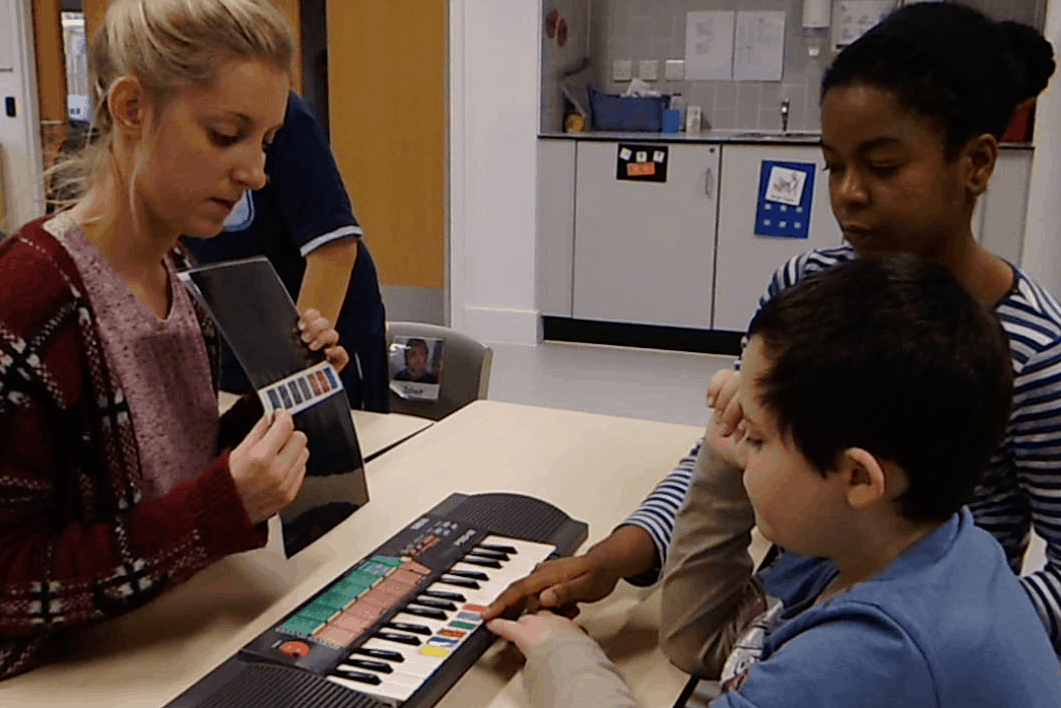 teaching autistic child to play keyboard using colour keys